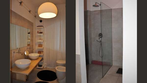 Bagno con doccia a pavimento appartamento in citt?.
